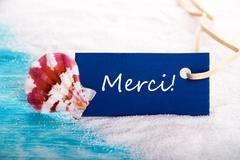 Nautical Background with the French Word Merci which means Thanks Stock Photos