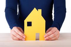 A Woman Holding a House, Isolated on White Stock Photos