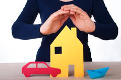 Womans Hands Guarding a House, a Car and a Boat, Isolated Stock Photos