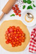 Cherry tomato tart. Cooking process. - stock photo