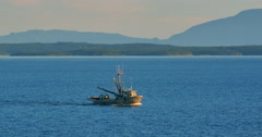 4K Tracking Shot of Old Fishing Boat Sailing during Golden Hour, Open Sea Stock Footage