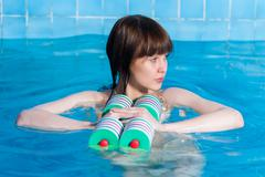 Pretty girl doing aqua aerobic exercise - stock photo