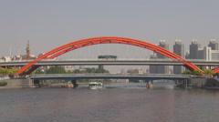 Tianjin panorama city Jingang Bridge Hai River traffic street boat cruise sail  Stock Footage
