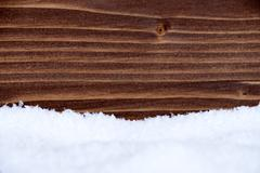 Snow and Wood as Winter Background - stock photo