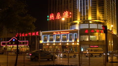 Timelapse traffic street car pass busy road Tianjin neon sign building commuting - stock footage