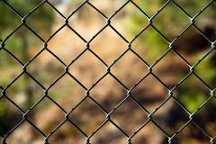 Diagonal Diamond Pattern Chain Link Fence Outside Boundary - stock photo