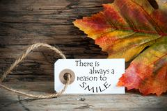 Fall Background with a Label on which stands There is Always a Reason to Smil Stock Photos