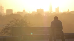 Silhoutted Couple Watch Sunrise over London | HD 1080 Stock Footage