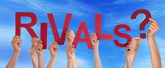 Many Hands Holding the Red Words RIvals in the Sky - stock photo