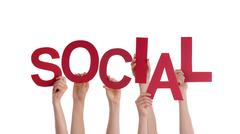 Many Hands Holding the Red Word Social, Isolated - stock photo
