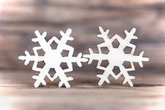 Two Snowflakes on Wood, Light Winter or Christmas Background - stock photo