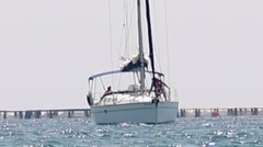 Prepairing the sailing boat near the port Stock Footage