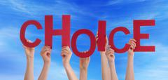Many Hands Holding Choice in the Sky - stock photo