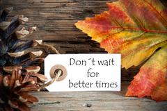 A Fall Label with the Words Donts Wait for Better Times, on Wood Stock Photos