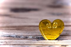 Macro of a Little Heart on a light Wooden Background - stock photo