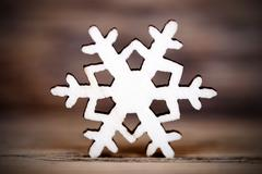 A Single Snowflake on Wood, Winter Background - stock photo