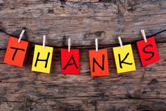 The Word Thanks on Colorful Tags on a Line on Wood Stock Photos