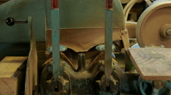 Machine is sanding the clogs from a wooden block Stock Footage