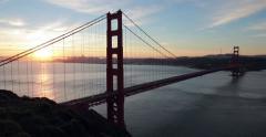 San Francisco Golden Gate Bridge pan sunrise morning Stock Footage