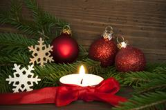 Stock Photo of Winter or Christmas Background in Red Colors with Candle
