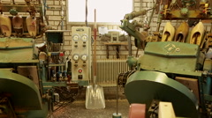 Machinery at a clog factory Stock Footage