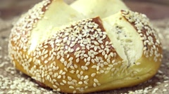 Pretzel Roll with Sesame (seamless loopable) Stock Footage
