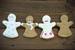 Four Different Happy Ginger Bread Woman on Wooden Background - stock photo