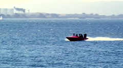 A speed boat sailing through the San Diego bay Stock Footage
