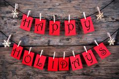 Happy Holidays Greetings on a Line - stock photo
