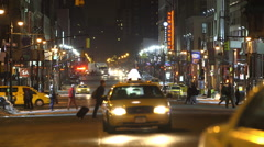NYC Cars and Cabs. Cars Driving North on 8th Avenue. West Side New York Night. Stock Footage