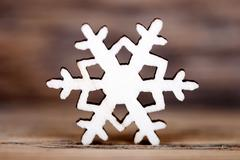 A Snowflake on Wood, Single Snowflake, Wooden Christmas or Winter Background Stock Photos