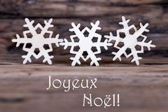Snowflakes with Joyeux Noel Stock Photos