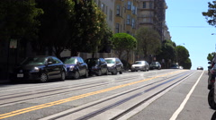 A cable car goes up a hill in San Francisco. Stock Footage
