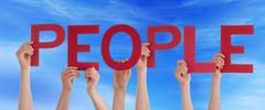 Many Persons Holding the Red Word People in the Sky - stock photo