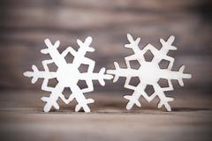 Two Snowflakes on Wood, Dark Winter or Christmas Background Stock Photos