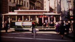 290 - trolley car at turn-about on busy city street - vintage film home movie Stock Footage