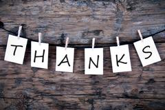 The Word Thanks on White Labels on Wood Stock Photos