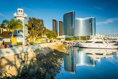 Marina and buildings reflecting at the Embarcadero in San Diego, California. Stock Photos