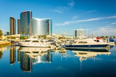 Marina and buildings reflecting at the Embarcadero in San Diego, California. - stock photo