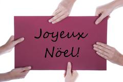 Hands Holding Sign Joyeux Noel - stock photo