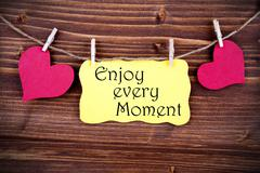 Yellow Lable Saying Enjoy Every Moment Stock Photos