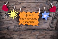 Orange Label With Life Quote Life Is To Short To Waste A Moment Stock Photos