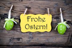 Yellow Easter Label With Frohe Ostern - stock photo