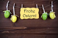 Yellow Label With Four Easter Eggs And Frohe Ostern Stock Photos