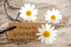 Brown Label With Life Quote Always Be Yourself And Marguerite Blossoms - stock photo