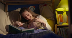 Bedtime reading loving moment mum and son - stock footage