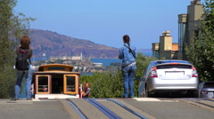 A cable car rises over a hill in San Francisco. Stock Footage