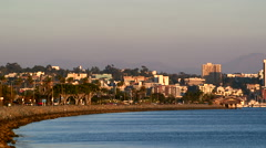 Pan shot of San Diego Bay with downtown skyline in the evening Stock Footage