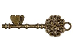 Key from the heart, a symbol of romantic relationships, isolated on white bac - stock photo