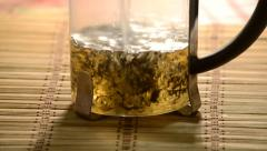 Brewing black tea in french press. Stock Footage